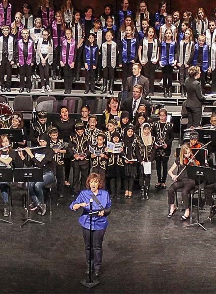 Lisa Meyer leads the combined orchestras and choirs at the Youth Arts Festival at the Ford Community and Performing Arts Center.