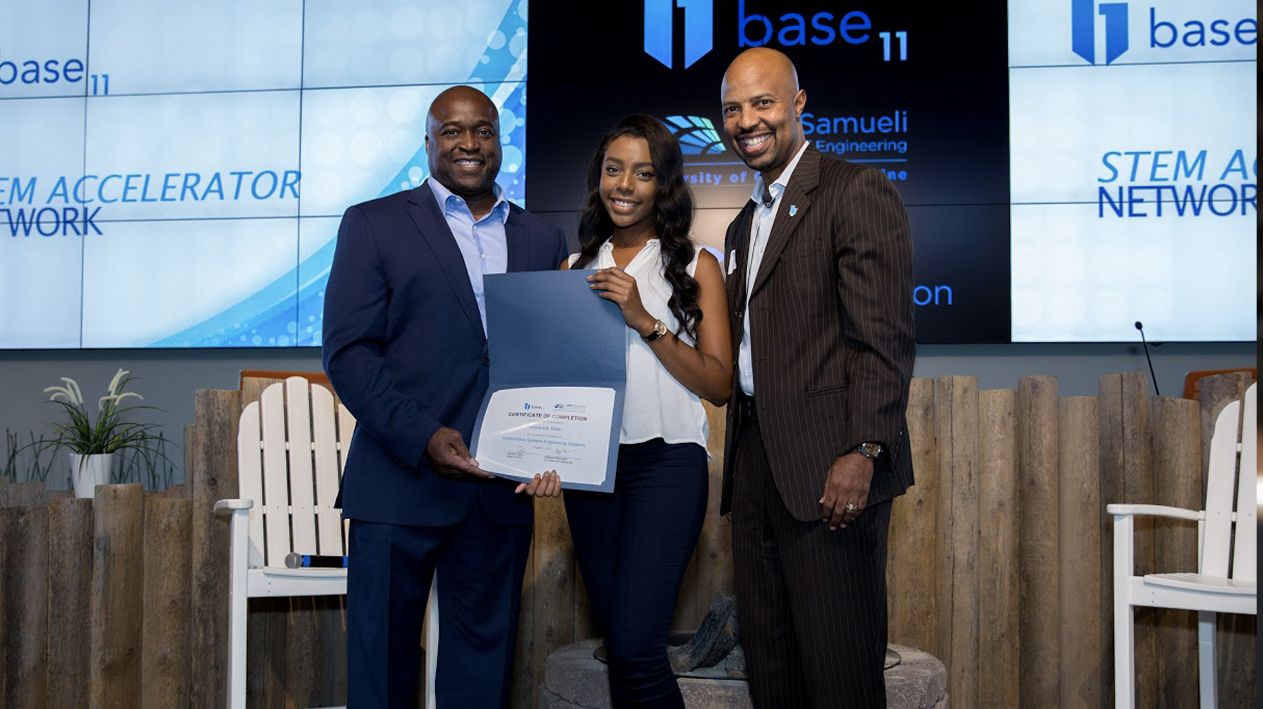 Photo: Breanna Allen, center, receives her certificate of completion for the University of California-Irvine Autonomous Engineering Academy.