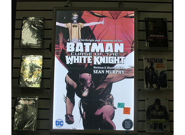 """One of the myriad titles prominently displayed at Green Brain Comics is DC Comics' """"Batman: Curse of the White Knight."""""""