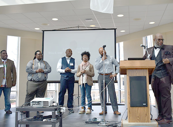 Dr. Kalvin Harvell, right, with members of the Black Male and QUEENS Focus Group at last year's conference.
