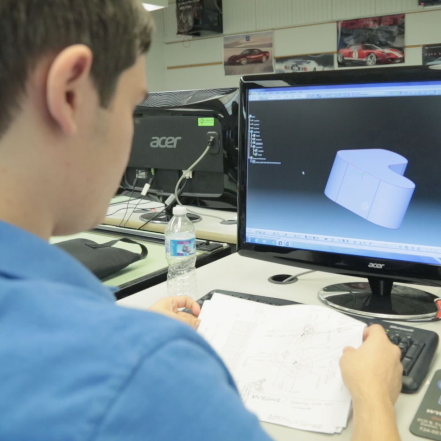 Student diligently modeling a part on CAD computer program