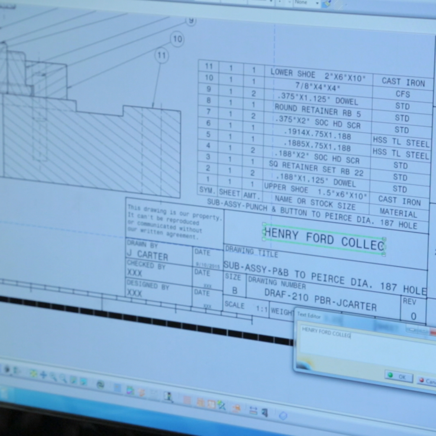 Computer screen closeup showing measurements and materials next to a diagram of a part
