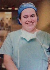 Monica in hospital scrubs.