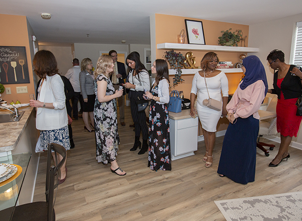 Students and guests peruse the 2-bedroom corner apartment.