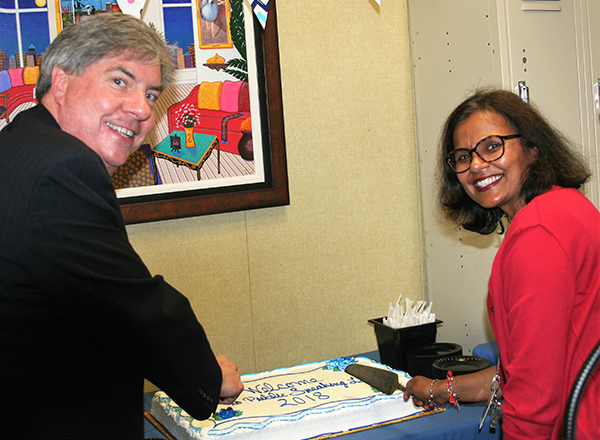Dr. Michael Nealon, HFC Vice President of Academic Affairs, and HFC speech instructor Vinita Parekh cut the cake at the Public Speaking Lab opening house Aug. 29.
