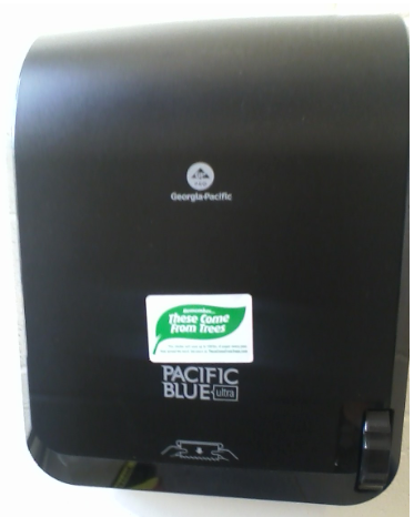 """HFC paper towel dispenser with """"Remember...These Come from Trees"""" stickers."""