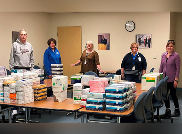 L to R: HFC School of Health and Human Services faculty and staff members Rob Bruley, Susan Shunkwiler, Lisa Hastings, Debra Szymanski, and Cynthia Scheuer collect medical supplies to donate to area hospitals.