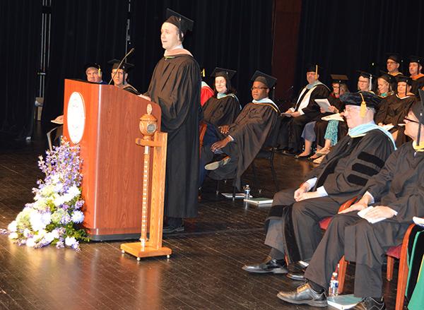 Nick Ilitch, commencement speaker, addresses the graduating class