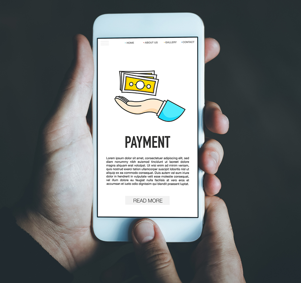 "Hands holding smartphone with ""Payment"" app."