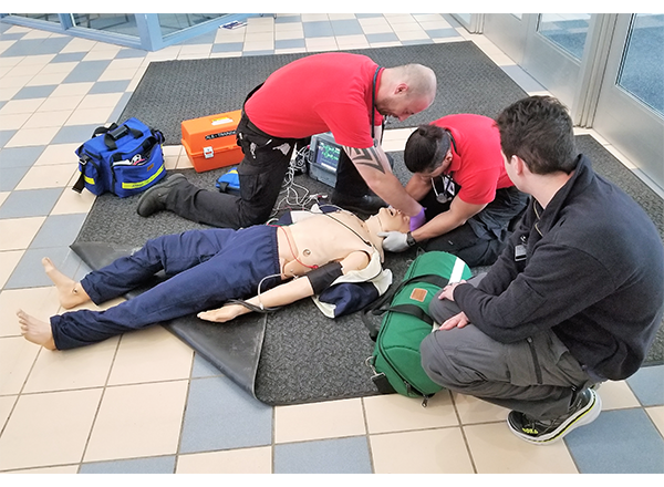 HFC EMS students assist Kelly, a human patient simulator.
