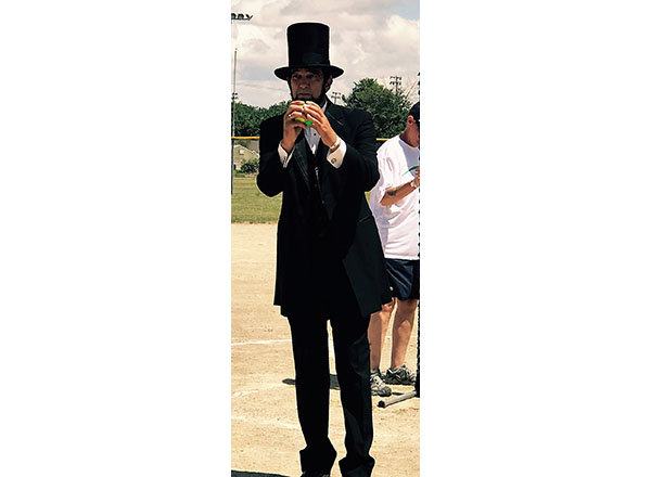 Abraham Lincoln (Ron Carley) throws the first pitch at the Celebrity Softball Tourney in Ferndale this past July.