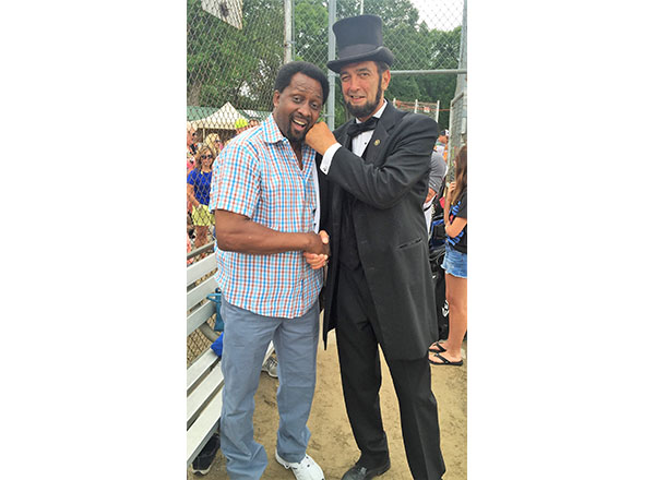 "Boxing legend Tommy ""The Hitman"" Hearns (right) and Abraham Lincoln (Ron Carley)."