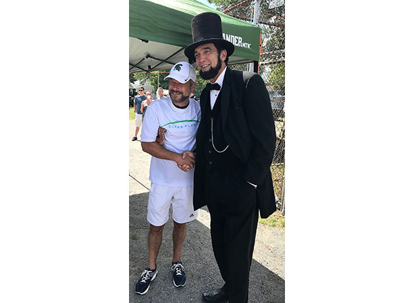 Local 4's Jason Carr (left) and Abraham Lincoln (Ron Carley).