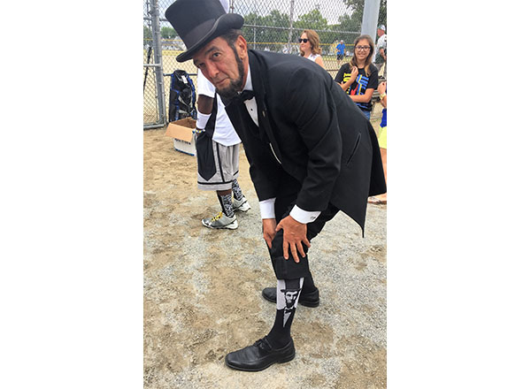 Abraham Lincoln presenter Ron Carley shows off his Lincoln socks.