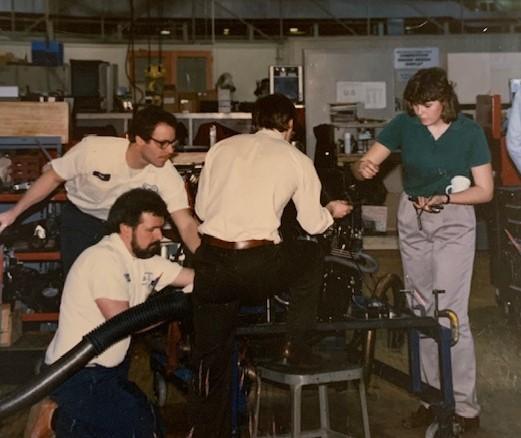 HFC alumna Linda Conti (far right) as an intern for General Motors.