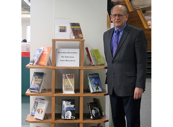 John McDonald with the Library of Labor Studies in the Eshleman Library.
