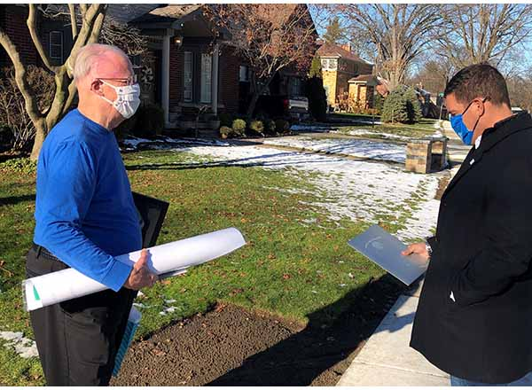 Because the coronavirus pandemic made it impossible to have a farewell party for Trustee Dr. Michael Meade (left), HFC President Russell Kavalhuna (right) presented him with a gift at his home in Dearborn. People affiliated with HFC and Dearborn Public Schools, as well as community members, drove by Meade's house, waving and honking their horns, expressing their thanks for his service to the Board.