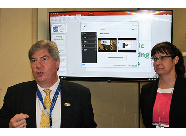 Dr. Michael Nealon, HFC Vice President of Academic Affairs, and Dr. Jennifer Ernst, Dean of the HFC School of Liberal Arts, speak at at the Public Speaking Lab opening house Aug. 29.