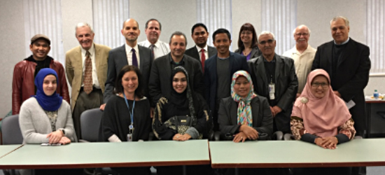 Photo courtesy Sam Bazzi: Mike Daher, standing, second from left, with a group of HFC faculty members hosting guests from Indonesia at HFC, March 2018.