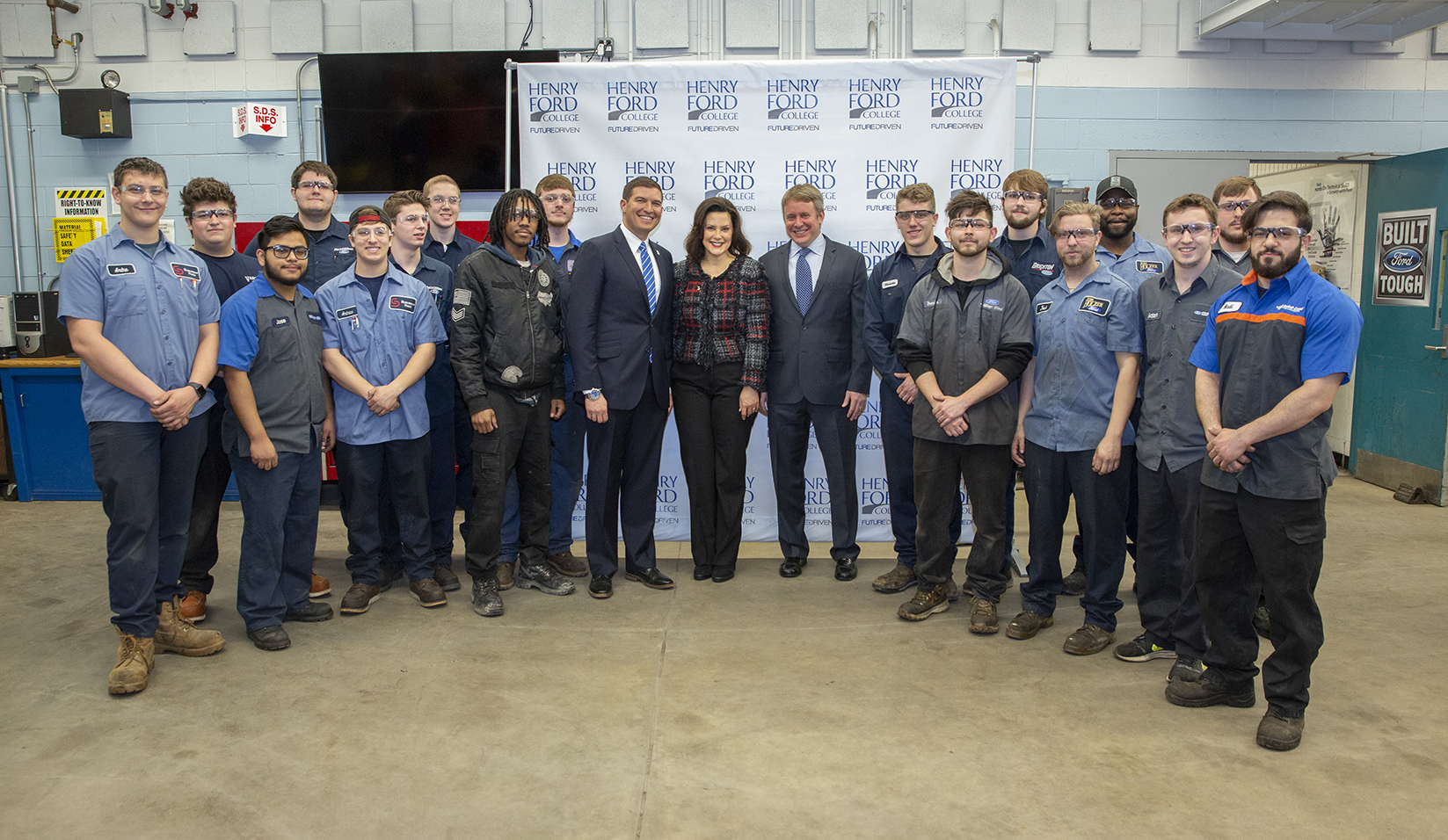 Governor Whitmer with a class of HFC automotive tech students, President Kavalhuna, and Henry Ford III.