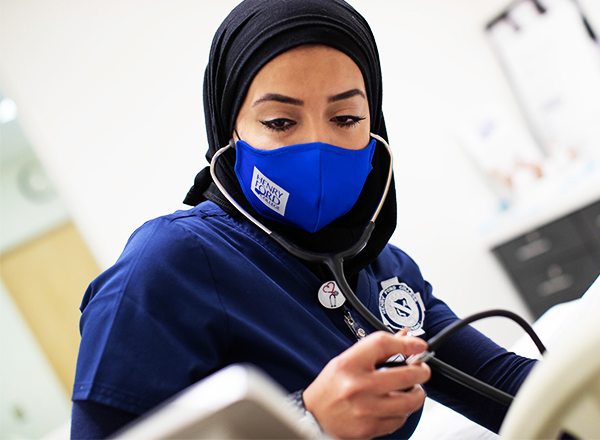 Henry Ford College student wearing a face mask.