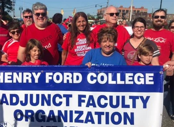Photo: AFT Local 337 President Lynn Boza (center, blue shirt) and many HFC colleagues and their families proudly participate in the annual Labor Day march in Detroit.