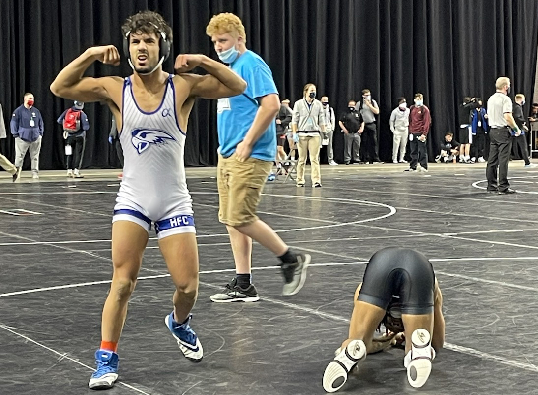 Almudhala celebrating on the mat after his victory to take 6th place at nationals