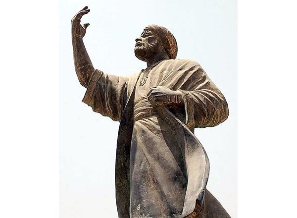 Statue of a Muslim man