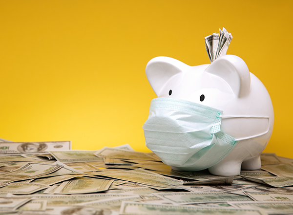 White piggy bank wearing mask on top of money, with yellow background.