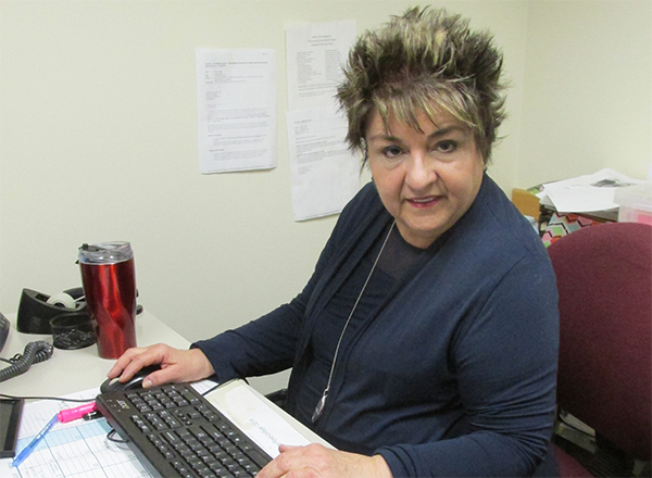Lynn Boza at her desk