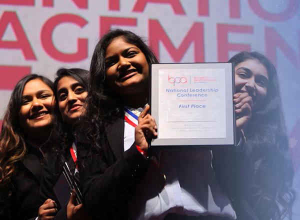BPA students holding an award