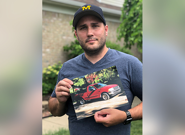 HFC alumnus Rob Brancheau holds a photo of his first F-150, a used 1997 model. He currently works on the design team on the 2021 F-150 at Ford Motor Co. in Dearborn.