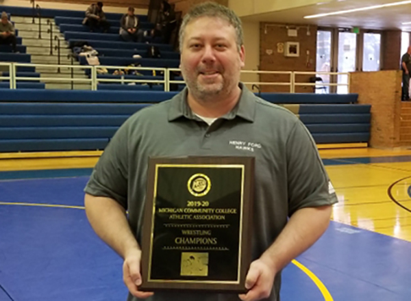 "HFC wrestling coach Grant MacKenzie, the MCCAA Coach of the Year, was a guest recently on ""The Combat Sports Podcast."""