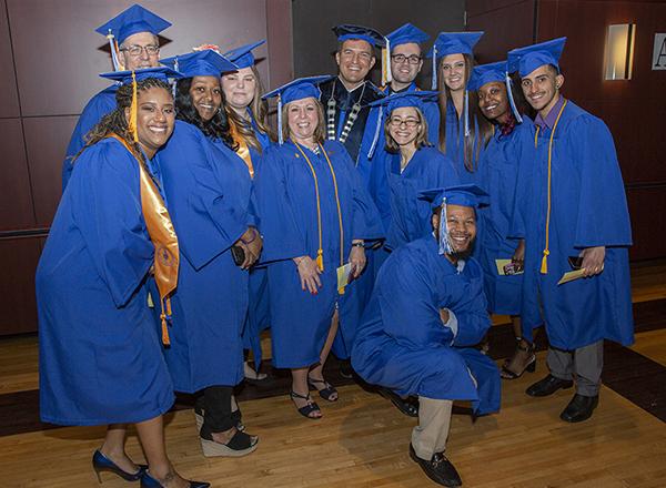 Proud graduates in regalia