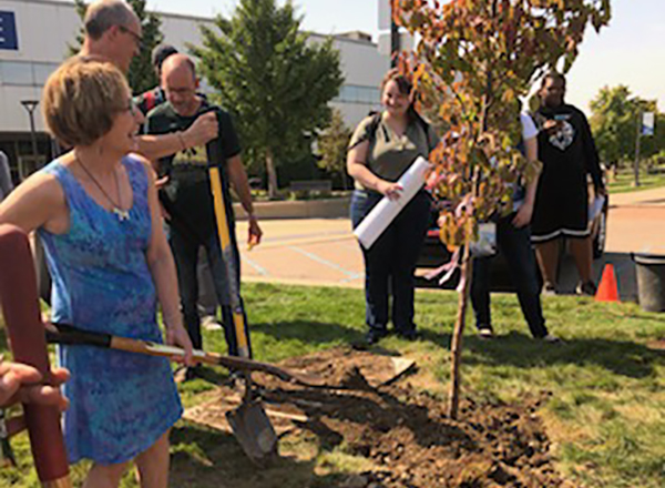 Linda Brandt, left, and colleagues planted a tree during last September's Climate Forum. This year's Earth Day activities have been postponed, but will take place when it is safe to hold them.