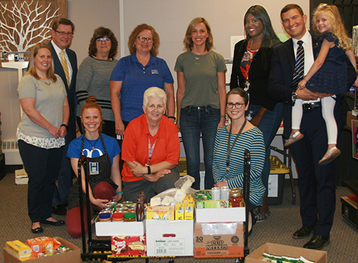 The HFC Hawks' Nest food pantry had a successful food drive to start the 2019 year. Here, HFC employees and donors, including President Russell Kavalhuna (with daughter Samantha) and Courtney Kavalhuna (rear, center), pose in front of several boxes of food donations.