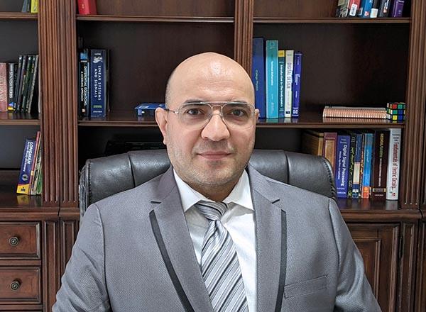 A headshot of Hassan Mohseni Nameghi.