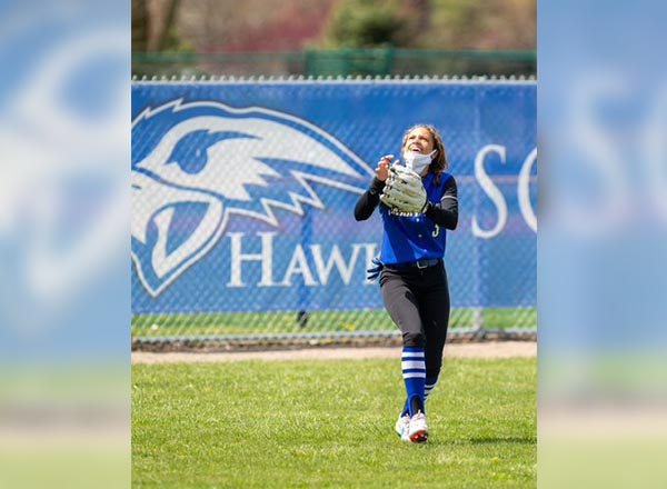 HFC softball player in the outfield.