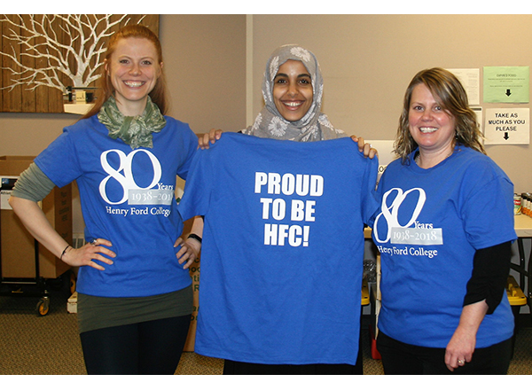 3 women wearing the HFC 80th Anniversary tees
