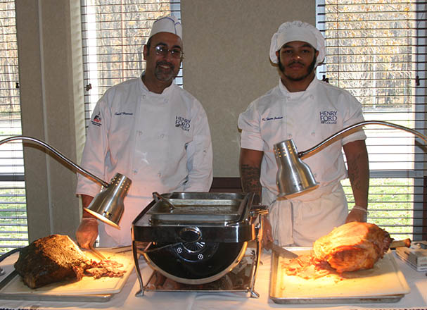 photo of 2 culinary students at their food stations