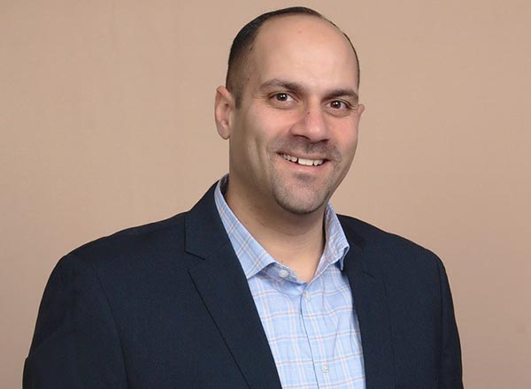 A headshot of Kamel Elkadri.
