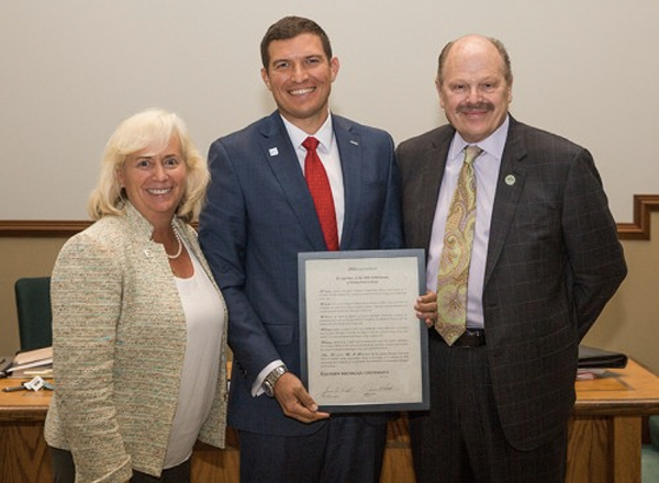 EMU Regent Mary Treder Lang and EMU President James Smith present the resolution to HFC President Russell Kavalhuna.