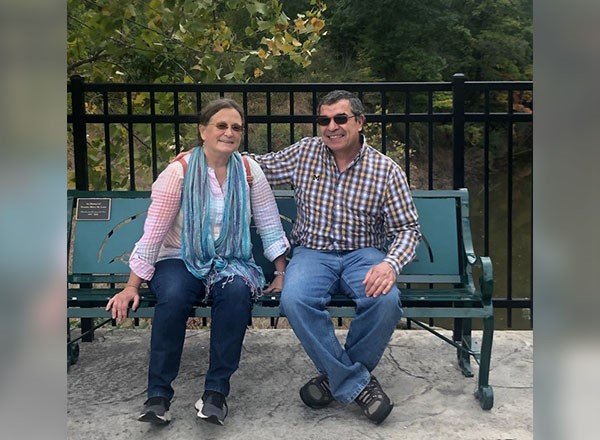 Mary Lane and husband sitting on bench.