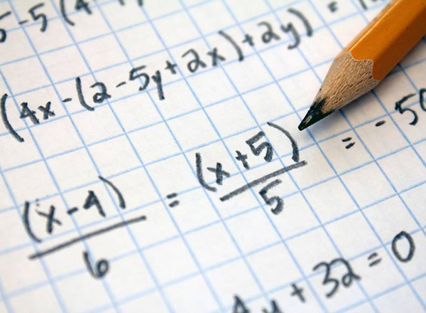 Photo of mathematical equations and a pencil