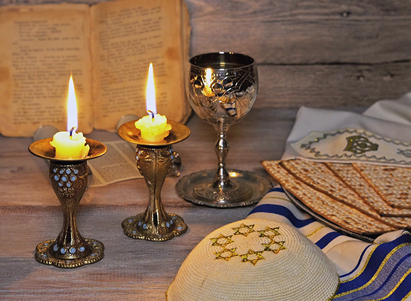 Candles, wine cup, Haggadah, matzah, other emblems of Passover
