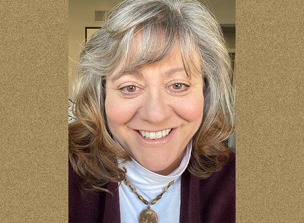 A headshot of Patricia Lanzon.