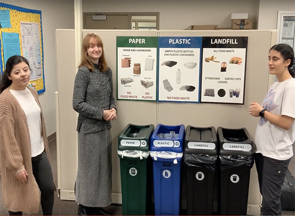 HFC students talk about the new recycling program, displaying the bins and signage.