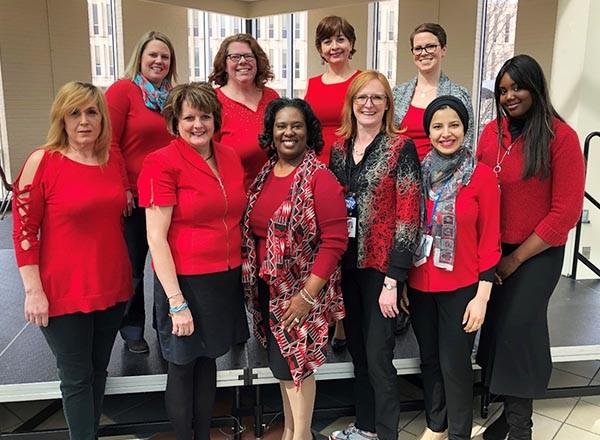 Photo: 10 HFC women wearing red