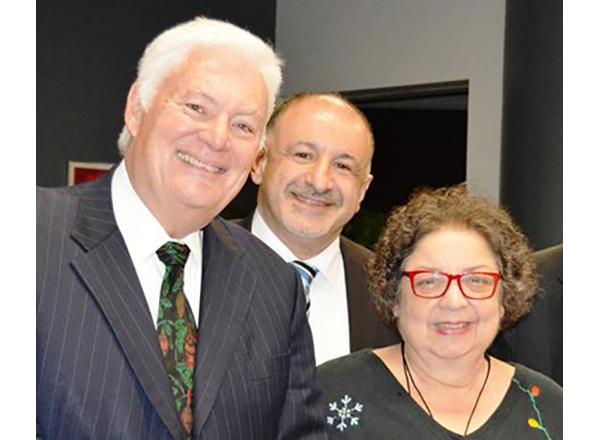 Former Trustee James Schoolmaster and Trustee Hussein Berry with former Trustee Pamela Adams, ca. 2014.