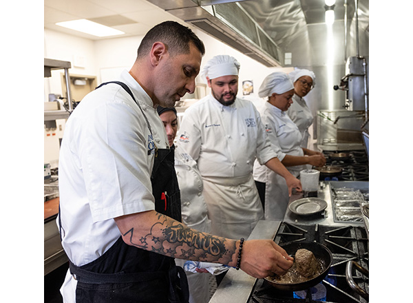 Chef Cosenza in the kitchen with students
